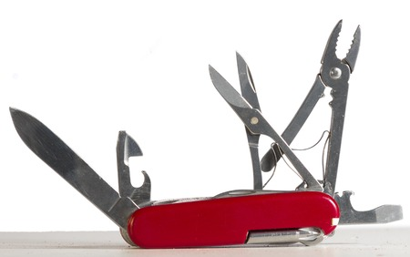 red multi tool knife, with several open tools