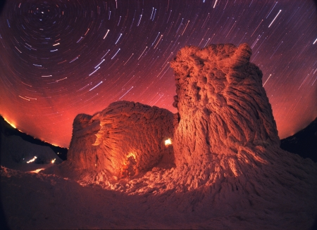 Over the snowy remnants of Polish observatory rotates beautiful sky. All highlighted hand lamps. photo