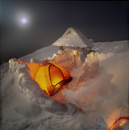 New Years trip to the highest mountain of Ukraine, overnight in tents, surrounded by a wall of wind- Stock Photo