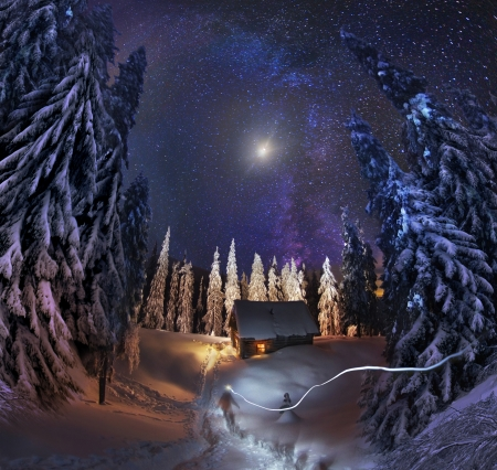 Traveling through the winter mountains, bold and romantic people can find shelter in the hunting huts, Glued to the panorama at a slow. The Milky Way as smoke rises over the frozen nature... photo