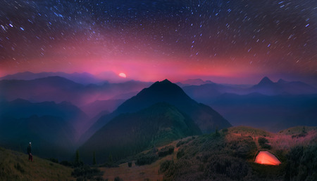 A beautiful moonrise in the foothills of the Alps affect the viewers imagination, dense virgin forests on the slopes contribute to conceal the traces of civilization photo