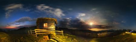 moonrise: Carpathian landscape at night, on a deserted pasture. The rising moon illuminates the space of the mountains, where shepherds soon hutsuly prigonyat flocks of sheep. Far-ridge Chernogora with the highest peak-Goverla.