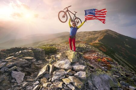 trenches: American racer autumn marathon route passes the tourist route in the wild mountains and fortified trenches dug the First World War with the United States flag United States of America