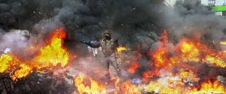 maidan: Young rebel calls for a rally... a clash of radical Protestants Maidan right sector with riot police forces of Yanukovych in the street Grushevskogo - the conflict moved to the street fighting Stock Photo