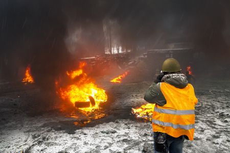 Ukraine, Kiev, 22 January 2014: a clash of radical Protestants Maidan right sector with riot police forces of Yanukovych in the street Grushevskogo - the conflict moved to the street fighting