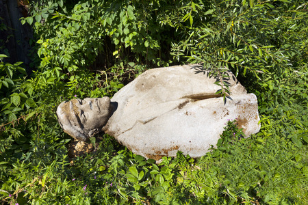 idols: Ukraine, Yasinya, July 31, 2016: remains of Vladimir Lenin in a ditch. days of the Soviets Lenin monument  concrete idols were in every village now people recover them to the dustbin of history