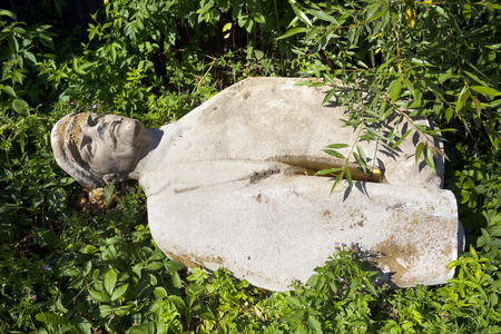 Ukraine, Yasinya, July 31, 2016: remains of Vladimir Lenin in a ditch. days of the Soviets Lenin monument  concrete idols were in every village now people recover them to the dustbin of history