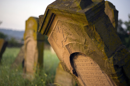 Ukraine, Galich- 24, July, 2015: At the Karaite cemetery in the village Zalukva near Galich (Ivano-Frankivsk region, Ukraine) remained around 200 gravestone monuments. The oldest of them dated from the mid-XVIII century