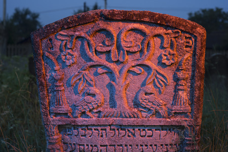 hebrew script: Ukraine, Galich- 24, July, 2015: At the Karaite cemetery in the village Zalukva near Galich (Ivano-Frankivsk region, Ukraine) remained around 200 gravestone monuments. The oldest of them dated from the mid-XVIII century