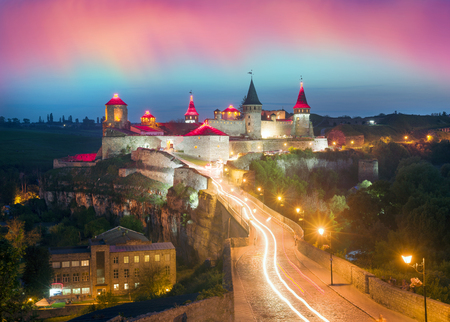 Old Castle Kamenetz-Podolsk medieval castle town of Kamenetz-Podolsk, Ukraine is one of the historical monuments. View of a beautiful evening with illumination  city lights in the night sky Editorial