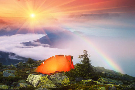 panoramas: after a rain on a background of fog Ukrainian mountain ridges. Panoramic views from the top of the Hamster, which sleeps Ukrainian tourists for beautiful panoramas Carpathians dawn