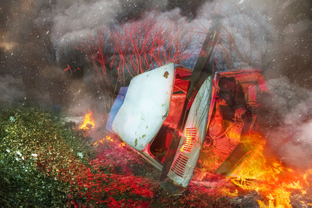 ignited: The car went off the track failure faulty brakes on the slopes led to trouble. The driver survived, because the fall was stopped by the bushes on the hillside, but the car ignited and exploded Stock Photo