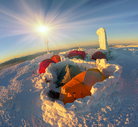 strengthening: Dawn of January 1, 2016: Climbers tradition of the New Year holiday on the highest peak of Ukraine - Goverla, Montenegrin Mountains. Snow strengthening of storms and hurricanes Editorial