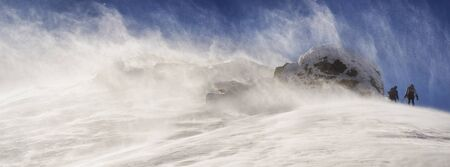 Winter is on the top of the Carpathians Smotrych terrible storm blizzard hurricane flags mark snow storm knocked down, posing a danger to climbers and travelers trekking ceases extreme