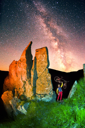 rock Montenegro beautiful figures famous landmark in the tract Gudgeon, Ukraine illuminated artistically beautiful lantern light under a starry nebom which climb athletes  tourists, cyclists Stock Photo