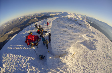 Ukraine, Vorohta- January 1, 2016: Climbers tradition to celebrate the New Year holiday on the highest peak of Ukraine - Goverla, Montenegrin Mountains. Severe frost danger wind. Photos from the drone Editorial