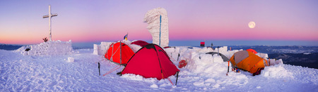 Climbers tradition to celebrate the New Year holiday on the highest peak of Ukraine - Goverla, Montenegrin Mountains. Severe frost danger destruction wind- climbing camp January 1, 2016