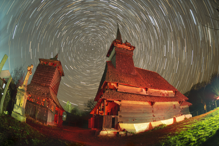 17th: Unique 17th century wooden churches in Transcarpathia, Ukraine-churches with tall towers and slender spiers, in county Marmarosh- wooden gothic, oak. Night astronomical filming with lanterns.