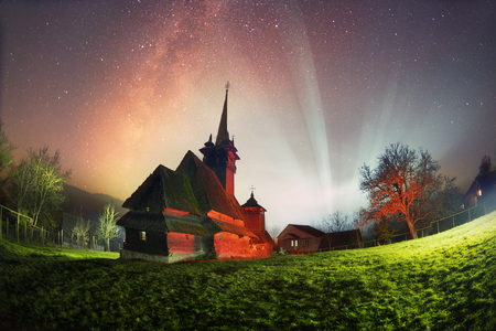 Unique 17th century wooden churches in Transcarpathia, Ukraine-churches with tall towers and slender spiers, in county Marmarosh- wooden gothic, oak. Night astronomical filming with lanterns.