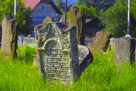 remained: Ukraine, Galich- July 18, 2015: At the Karaite cemetery in the village Zalukva near Galich (Ivano-Frankivsk region, Ukraine) remained around 200 gravestone monuments. The oldest of them dated from the mid-XVIII century.