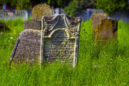 remained: Ukraine, Galich- July 18, 2015: At the Karaite cemetery in the village Zalukva near Galich  remained around 200 gravestone monuments. The oldest of them dated from the mid-XVIII century.