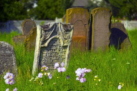Ukraine, Galich- July 18, 2015: At the Karaite cemetery in the village Zalukva near Galich (Ivano-Frankivsk region, Ukraine) remained around 200 gravestone monuments. The oldest of them dated from the mid-XVIII century.