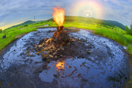 eruptive: Only in the Carpathians active mud (clay and bitumen) volcano on the outskirts of the village Starunov. Formed in 1977 on the site of an old oil field after the earthquake in Romania. Stock Photo