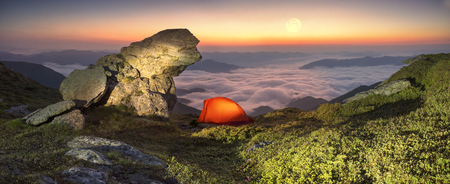 High in Ukraine -Smotrych mountain when the snow melts and becomes warmer - in the spring  summer is pleasant to put up tents on the top of the mountain - it's fantastic fantastically beautiful  romantic Imagens - 63310967