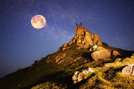 unearthly: Artistic lighting unreal mountain scenery while rock climbing in the wild mountains provides a unique fantastic effect unearthly planets with fabulous landscapes of Mars