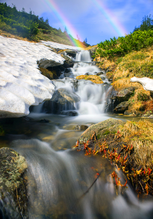 The highest waterfall in Ukraine - on the Prut River, under the top Goverly- Montenegrin Ridge, bushes creeping pine and alder rumbles rough water when the snow melts.