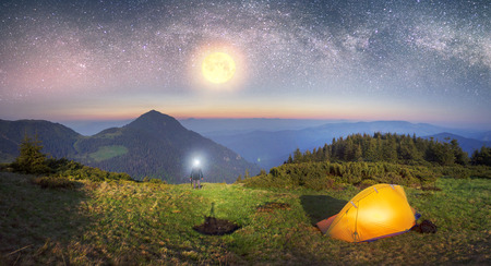 High in Ukraine - Marmarosh mountain when the snow melts and becomes warmer - in the spring  summer is pleasant to put up tents on the top of the mountain - its fantastic fantastically beautiful  romantic Stock Photo
