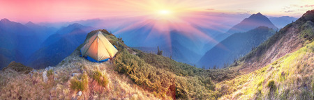 High in Ukraine - Marmarosh mountain when the snow melts and becomes warmer - in the spring and summer is pleasant to put up tents on the top of the mountain - its fantastic fairytale beautiful and romantic