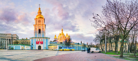 Ukraine, Kiev - 20 April 2015: Evening view of the spring against St. Michaels Square with monuments, St. Michaels Cathedral, bell tower at sunset with beautiful clouds