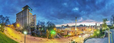 kyiv: Kiev, Ukraine, April 20, 2015: Evening view of the Independence Square background with monuments, Stella, Institutskaya Street, Performing Arts, Stalin and modern architecture and picturesque clouds in the sky Editorial