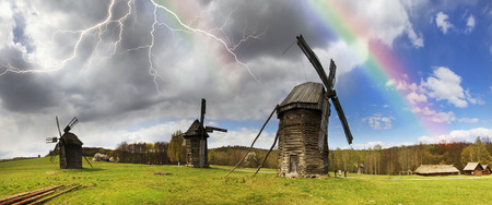 Spring in the National Museum of Architecture in Pirogovo, where a rich collection of ancient wooden windmills, houses, outbuildings including an abundance of gardens and flowers Editorial