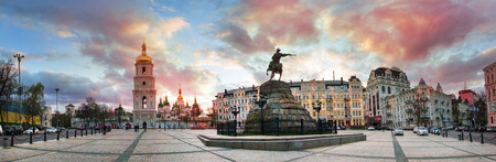 kyiv: Kiev, Ukraine, April 20, 2015: Evening spring panorama Sophia Square with the monument to Bogdan Khmelnitsky, St. Sophia Cathedral, bell tower and the townspeople at sunset Editorial