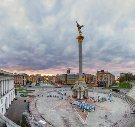 maidan: Kiev, Ukraine, April 20, 2015: Evening view of the Independence Square background with monuments, Stella, Institutskaya Street, an exhibition of photographs ATO, Stalin and modern architecture