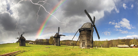 pirogovo: Spring in the National Museum of Architecture in Pirogovo, where a rich collection of ancient wooden windmills, houses, outbuildings including an abundance of gardens and flowers Editorial