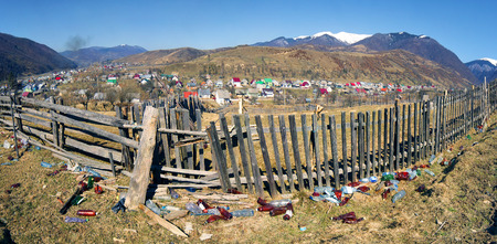 Villagers Transcarpathia throw trash in the same place and live on a background of mountains and pure nature - In Kolochava no special places for recycling. This is a large cultural and environmental issues. Stock Photo
