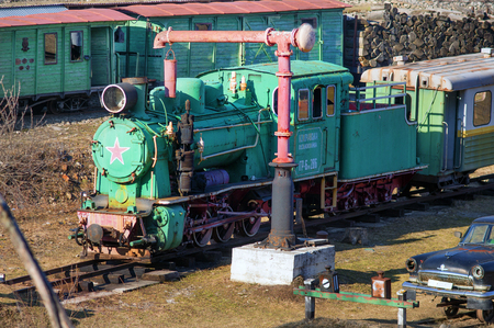 narrow gauge railroads: Kolochava, Ukraine - 23 March 2015: Network of narrow-gauge railway was built in the Carpathian region in the late XIX century. In Kolochava on the tracks should train consisting of a locomotive and ten passenger and freight cars. Many tools and devices u