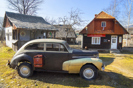 UKRAINE, Kolochava- March 23, 2015: Retro car in the Ukrainian Carpathians shows the life and production of the Soviet Union after the war. Car copied from Western models and attracts tourists with historical curiosities lovers