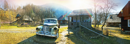 copied: Ukraine, Kolochava- May 23, 2015: Retro car in the Ukrainian Carpathians shows the life and production of the Soviet Union after the war. Car copied from Western models and attracts tourists with historical curiosities lovers