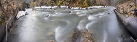 ecologically: Mountain River Black Cheremosh about Verhovina fast flowing and rocky rapids, Carpathian region - early spring. Ecologically clean water, wild mountains around, amid beech and spruce forests and stones Stock Photo