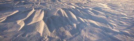 high winds: very mysterious and fantastic at sunrise, sunset and moonlight snow space of high mountains Ukraine- Ukrainian Carpathians, carved by the winds, blizzards, storms and snowfall in decorative patterns and figures