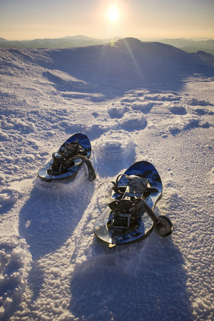 expeditions: Ukraine, Verhovina- 12 February 2015: Travellers ascenders leave traces of skis and snowshoes on the slopes of steep mountains in the Alps. Quality equipment is very helpful in extreme climbers and hikers traveling in the winter expeditions