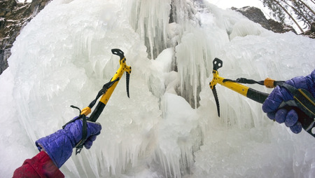 crampon: Alpine river Carpathian Ukraine, Manyavsky famous waterfall beautiful ice and icicles, where athletes train for climbing challenging routes high mountains of the Alps, the Caucasus, the Himalayas, the Pamir, and the Andes Cordillera
