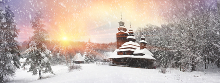 pout: After sunset, the traditional Ukrainian village began snowfall and blizzards, snowdrifts pout and covered the roads and footpaths. Thick forest and gardens beautiful pattern on the background of sky Editorial