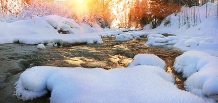 Lace ice frozen moisture admired his tenderness and subtlety. Babbling like a bell, cheerful mountain stream is clean water in the river, which give the water town at christmas
