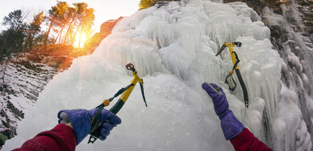 icefall: Icefall - alpinists, climbers, ascenders, hikers are training it to rise on the big mountains. Extreme sport requires courage, experience and equipment for mining safety and success climber