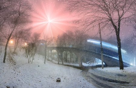 night before christmas: Funicular from hem to St. Michaels sobor- evening night shot during a snowfall fog, among the trees of the old capital of the park during the illuminations before Christmas and New Year Stock Photo